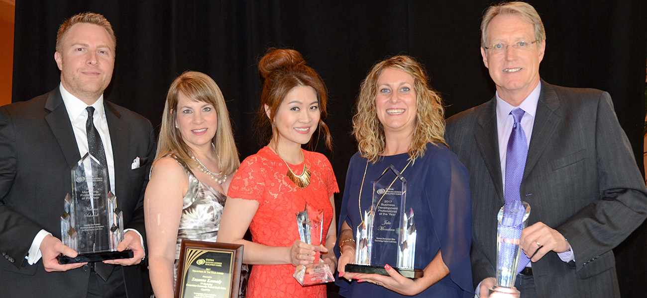 Six honored for marketing, business development