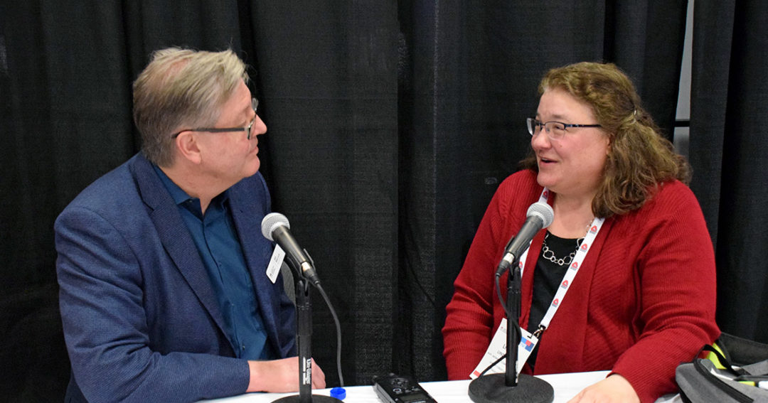 Linda Voit discusses Summit Credit Union's financial education efforts with CUNA's Bill Merrick